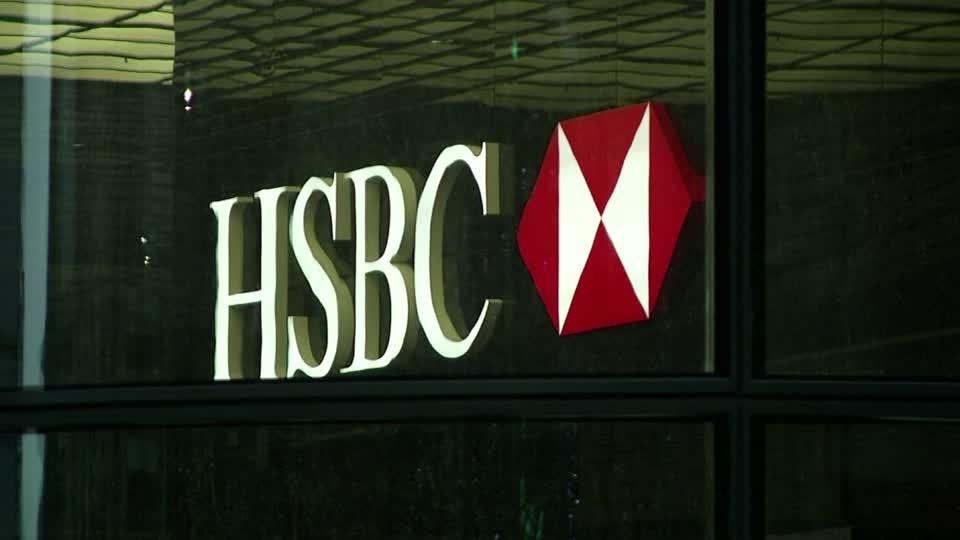 HSBC first-half profit plunges 65%