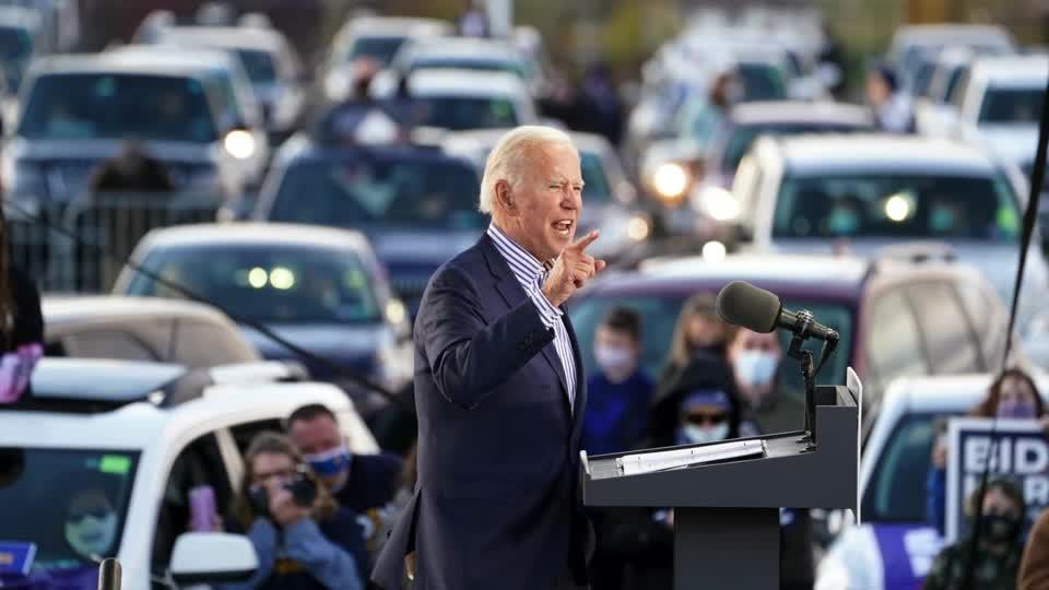 Biden, Trump show opposing views as COVID-19 surges