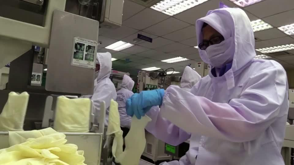 COVID outbreak hits top rubber glove maker