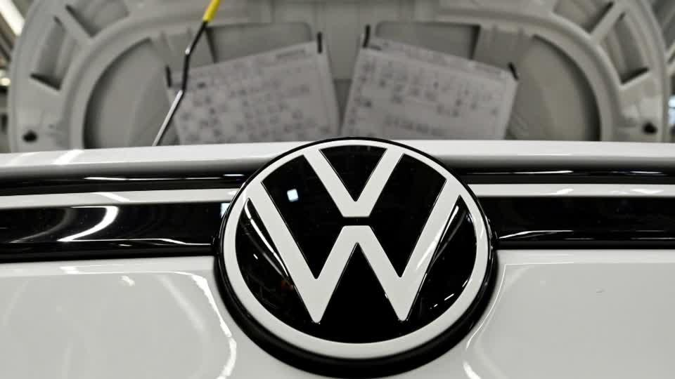 Volkswagen's profit halves, deliveries recovering