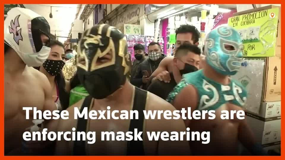 Lucha libre wrestlers enforce mask rules in Mexico City market