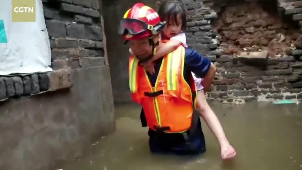 Rescuers carry children to safety in flood-stricken Anyang