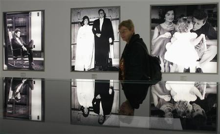 A woman walks past photographs at the exhibition ''The Kennedys'' in Berlin November 17, 2006. In a political landscape populated by Bushes, Kennedys and Clintons, the children and kinfolk of longtime U.S. politicians do indeed have a better shot at winning elective office, but not necessarily at holding on or moving up, experts say. REUTERS/Arnd Wiegmann