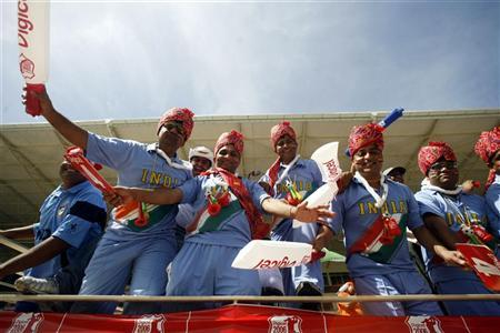 A file photo of fans of India's cricket team cheer for their team during a match in Kingston May 20, 2006. REUTERS/Arko Datt