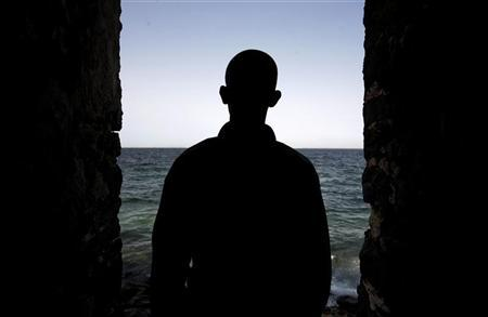 A man is silhouetted in the ''Door of No Return'' at the House of Slaves on Goree Island near Senegal's capital Dakar, March 16, 2007. Estimates vary widely, but somewhere between 10 and 28 million Africans are believed to have been shipped across the Atlantic between the 15th and 19th centuries. Many died on the way. Those who survived endured a life of drudgery on sugar, tobacco and cotton plantations. The world marks the bicentenary of the end of the Atlantic slave trade on March 25. REUTERS/Finbarr O'Reilly