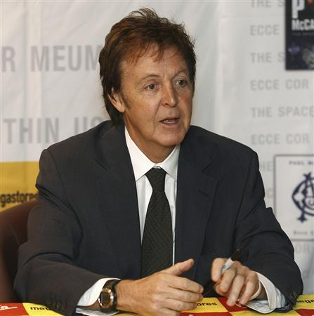 Paul McCartney Poses For The Media Before A Signing Session In London November 22 2006