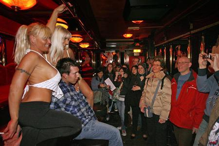 Visitors flood amsterdams red light district reuters banana bar dancers sunny l and love pose with a visitor during the open day of amsterdams red light district march 31 2007 reuterstoussaint kluiters aloadofball Gallery