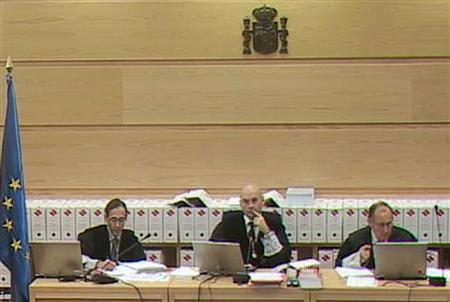 High Court's judge Javier Gomez Bermudez (C) presides over a trial session in this video frame grab taken inside an annex of the High Court in Madrid March 12, 2007. Despite a lack of direct evidence, almost one in five Spaniards believe Basque separatist rebels ETA participated in the bombings of four Madrid trains on the morning of March 11, 2004, killing 191 people, a recent poll showed. REUTERS/Pool