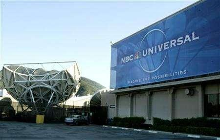 A large sign of NBC Universal Entertainment hangs on a building at the NBC studios in Burbank, California, in this May 19, 2004 file photo. NBC Universal has made a minor acquisition that will play a part in a major shift for its business down the road. REUTERS/Fred Prouser