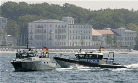 Police boats speed up during a presentation for the media in the Baltic sea in front of the venue for the upcoming G8 summit in Heiligendamm May 24, 2007. REUTERS/Fabrizio Bensch