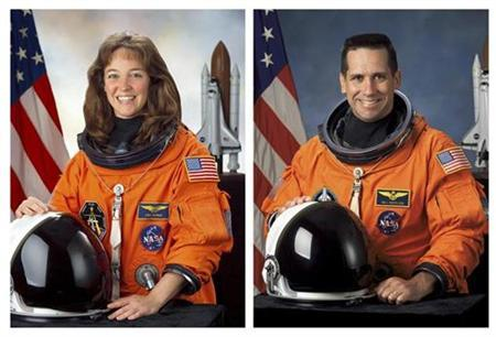 This combination photo shows NASA Astronaut Lisa Nowak (L) and William Oefelein in their official NASA portraits. The space agency has dismissed Oefelein, who was involved in a love triangle that led to a confrontation between Nowak and another woman in a Florida airport, a spokesman said on Friday. REUTERS/NASA/Handout