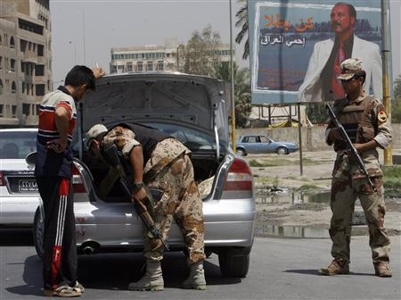 An Iraqi soldier checks the trunk of a vehicle at a checkpoint in Baghdad, June 5, 2007. REUTERS/Ceerwan Aziz