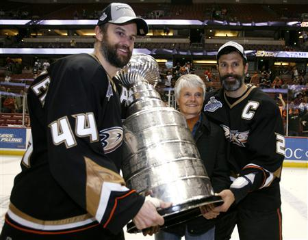Anaheim Ducks  brothers Rob (L) and Scott (R) Niedermayer and their mother  Carol pose with the Stanley Cup after beating the Ottawa Senators during  Game 5 ... c2ce8d1fb