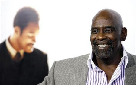 Chris Gardner, whose life the movie is based on, attends the world premiere of 'The Pursuit of Happyness' at the Mann Village theater in Westwood, California in this December 7, 2006 file photo. For Gardner fatherhood is the greatest job in the world. REUTERS/Mario Anzuoni