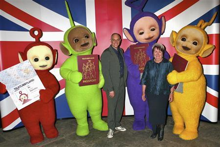 The Teletubbies celebrate their 10th birthday with co-creators Anne Wood and Andy Davenport in Stratford, Britain, in this undated handout photo, before heading to New York where they will receive the keys to the city. Babies and toddlers are enchanted by the Teletubbies with their brightly colored outfits and bulging tummies but when it comes to learning new words and language skills humans are the best teachers. REUTERS/Ragdoll Worldwide Ltd/Handout
