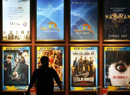 A Man Walks Past Movie Posters On Display At Multiplex Cinema In Mumbai July 23 2007 Not Too Long Ago Watching India Mostly Meant Standing
