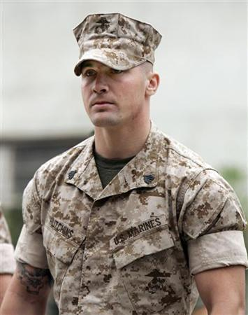 U.S. Marine Sgt. Lawrence G. Hutchins III arrives for his Article 32 Investigation hearing at Camp Pendleton, California October 16, 2006. The Marine squad leader who boasted to his men they had ''got away with murder'' after kidnapping and killing an Iraqi grandfather was sentenced on Friday to 15 years in prison. REUTERS/Mike Blake