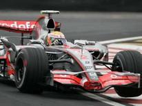 <p>Piloto britânico da McLaren Lewis Hamilton faz uma curva no circuito de Interlagos durante treino livre desta sexta-feira para o Grande Prêmio do Brasil. Photo by Sergio Moraes</p>