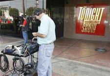 """<p>A sound technician stands where the audience normally gathers to enter studio's for NBC's """"The Tonight Show with Jay Leno"""" at NBC television network studios in Burbank, California November 5, 2007. A day after they learned that they would be laid off, employees of """"Tonight Show"""" have received news that Leno has decided to pay his non-writing staff out of his pocket through next week, sources said Saturday. REUTERS/Fred Prouser</p>"""