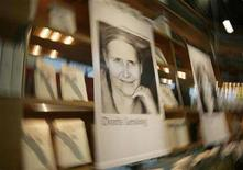 """<p>A portrait of Nobel prize winner of literature, Doris Lessing is seen at the fair booth of German publishing house """"Hoffmann und Campe"""" at the Frankfurt book fair, October 11, 2007. REUTERS/Kai Pfaffenbach</p>"""