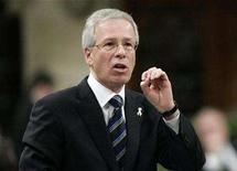 <p>Liberal leader Stephane Dion stands to speak in the House of Commons on Parliament Hill in Ottawa November 28, 2007. REUTERS/Patrick Doyle</p>