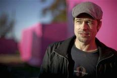 <p>Actor Brad Pitt stands amidst the Pink Project, metal frames draped in pink fabric, in the Lower Ninth Ward of New Orleans, December 3, 2007. REUTERS/Lee Celano</p>