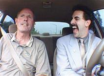 """<p>Borat (R) gets a driving lesson in the film """"Borat: Cultural Learnings of America for Make Benefit Glorious Nation of Kazakhstan"""" in an image courtesy of 20th Century Fox. The creators of the hit film were sued again on Tuesday, this time by a driving instructor seen in the comedy admonishing the fake Kazakh reporter for yelling insults at other drivers. REUTERS/Handout</p>"""