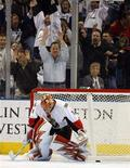 <p>Tampa Bay Lightning fans celebrate behind Ottawa Senators goaltender Ray Emery after he gave up the eventual game-winning shootout goal to Vaclav Prospal in their NHL hockey game in Tampa, Florida December 4, 2007. REUTERS/Mike Carlson</p>