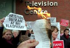 """<p>Members of various Christian organisations burn copies of TV licences in protest at the decision by the BBC to broadcast tJerry Springer - The Opera, outside BBC Television Centre in west London, January 7, 2005. Britain's High Court ruled on Wednesday that a Christian activist may not prosecute a BBC executive under blasphemy laws over its screening of """"Jerry Springer-The Opera"""". REUTERS/Stephen Hird</p>"""
