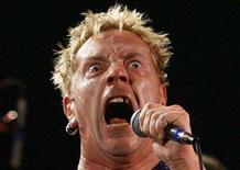 <p>Lead singer Johnny Rotten performs with the Sex Pistols at the Roxy bar in Los Angeles, October 25, 2007. Fresh from a brief reunion tour of Britain, the Sex Pistols will return to the road next summer, guitarist Steve Jones said on Wednesday. REUTERS/Mario Anzuoni</p>
