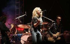 <p>Musician Robert Plant (C), formerly of Led Zeppelin, performs at the main stage during the Exit music festival in the Serbian town of Novi Sad July 12, 2007. REUTERS/Marko Djurica</p>