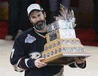 <p>Anaheim Ducks' captain Scott Niedermayer holds the Conn Smythe Trophy after being named MVP after Game 5 of the 2007 NHL Stanley Cup Finals in Anaheim June 6, 2007. Niedermayer will be back at practice on Thursday after deciding against retirement. REUTERS/Shaun Best</p>