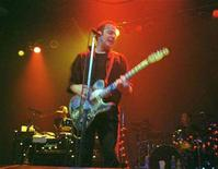 """<p>The late Joe Strummer, former lead singer of """"The Clash"""", pictured in this file photo performing in Toronto, Canada on November 25, 1999. Strummer's widow plans to publish a book based on some of the Clash front man's rare memorabilia jointly with artist Damien Hirst, she said in an interview published on Saturday. REUTERS/Masaru Sato JB/AA</p>"""
