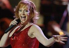 """<p>Country music singer Reba McEntire performs """"Fancy"""" during the finale of a taping of the Country Music Television special """"CMT Giants"""" in Hollywood October 26, 2006. McEntire's new """"Love Revival"""" will be sold exclusively at Hallmark Gold Crown stores in January and February, making the country singer the latest in a string of top artists to release albums through the retailer. REUTERS/Fred Prouser</p>"""
