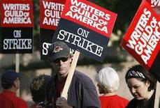 <p>Writers Steve Tomlin (L) and Kathy McWorter walk a picket line along with members of the Writers Guild of America at one of the gates to Sony Studios in Culver City, California November 5, 2007. Hollywood screenwriters went on strike against major film and television studios on Monday, knocking some of America's favourite TV shows out of production in a dispute that hinges on how the Internet is changing the face of show business. REUTERS/Mario Anzuoni</p>