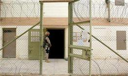 <p>A U.S. soldier stands in front of a facility where high risk detainees are kept in Abu Ghraib prison May 10, 2004 . An examination of human rights violations at Iraq's Abu Ghraib prison from U.S. director Errol Morris was among eight films selected on Monday for February's Berlin Film Festival. REUTERS/Pool/ Khampha Bouaphanh/Knight Ridder/Tribune</p>
