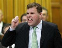 <p>Canada's Environment Minister John Baird stands to speak in the House of Commons on Parliament Hill in Ottawa December 6, 2007. REUTERS/Chris Wattie</p>