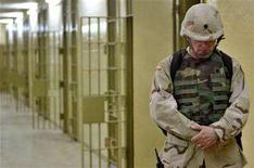 <p>A U.S.soldier walks through the prison of Abu Ghraib, outside Baghdad, May 5, 2004. Four world premieres, including a U.S. documentary about the Abu Ghraib prison scandal, will screen in competition at the 58th annual Berlin International Film Festival, organizers said Monday. REUTERS/Pool/Anja Niedringhaus</p>