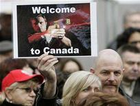 <p>A demonstrator attends a rally in memory of Robert Dziekanski in Vancouver, British Columbia, November 24, 2007. Dziekanski, a Polish immigrant, died on October 14th after he was hit by a Royal Canadian Mounted Police's Taser stun gun at Vancouver International Airport. Canada's national police force was urged on Wednesday to reduce its use of Taser electric stun guns and get more information on the weapon's dangers and benefits. REUTERS/Lyle Stafford</p>