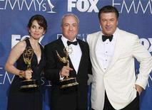 """<p>Actress Tina Fey (L) and producer Lorne Michaels (C) pose with the Emmy awards they won for Outstanding Comedy Series for """"30 Rock"""" next to series co-star Alec Baldwin (R) at the 59th Primetime Emmy Awards in Los Angeles, California September 16, 2007. REUTERS/Lucy Nicholson</p>"""