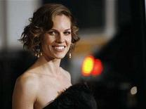 """<p>Cast member Hilary Swank poses at the premiere of """"P.S. I Love You"""" at the Grauman's Chinese theatre in Hollywood, California December 9, 2007. The movie opens in the U.S. on December 21. REUTERS/Mario Anzuoni</p>"""