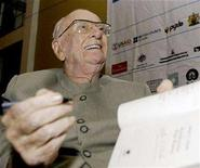 <p>Science fiction author Arthur C. Clarke signs copies of his books at The Galle Literary Festival January 14 2007. REUTERS/Buddhika Weerasinghe</p>