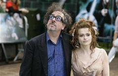 """<p>Actress Helena Bonham Carter [R] and her husband Tim Burton arrive at the British premiere of her new movie """"Harry Potter and the Order of the Phoenix"""" in London July 3, 2007 REUTERS/James Boardman</p>"""
