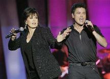 <p>Marie Osmond and her brother Donny perform during a 50th anniversary show at the Orleans hotel-casino in Las Vegas, Nevada August 13, 2007. REUTERS/Steve Marcus</p>