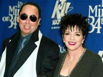 """<p>Singer Liza Minnelli and her husband David Gest pose for photographers backstage of the """"Miracle on 34th Street"""" concert hosted by radio station WKTU in New York City, December 18, 2002. REUTERS/Jeff Christensen</p>"""