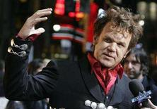 "<p>Actor John C. Reilly is interviewed as he arrives for the premiere of his film ""Walk Hard :The Dewey Cox Story"" in Hollywood, California, Dec. 12, 2007. REUTERS/Fred Prouser</p>"