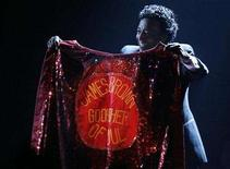 <p>Danny Ray holds James Brown's cape at the 49th Annual Grammy Awards in Los Angeles February 11, 2007 REUTERS/Lucy Nicholson</p>