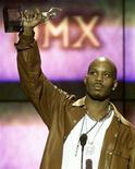 <p>Rapper DMX holds up his award after being named Male Entertainer of the Year at the 14th annual Soul Train Music Awards on March 4, 2000. After being released from his Sony Music deal earlier this year, DMX has signed a deal with the music division of Canadian online gaming company Bodog Entertainment. REUTERS/Gary Hershorn</p>