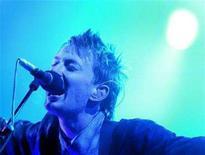 <p>In this file photo Thom Yorke, lead singer of Radiohead performs at the Glastonbury Festival in Somerset, June 28, 2003. Radiohead has hit out at the chief of its former label after a news report claimed the rock band rejected a 3 million pound ($5.95 million) advance for its new album and demanded the rights to some of its older albums. REUTERS/Toby Melville</p>