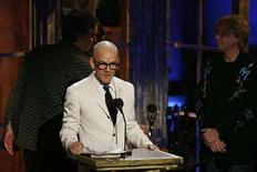 """<p>Band members of """"R.E.M."""" Michael Stipe (C), Paul Buck (L), Bill Berry (2nd L) and Michael Mills address the audience during their induction at the 22nd annual Rock and Roll Hall of Fame induction ceremony at the Waldorf Astoria Hotel in New York March 12, 2007. REUTERS/Lucas Jackson</p>"""